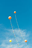Balloons with Streamers in a Blue Sky Royalty Free Stock Photography