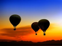 Balloons at sunset Stock Photos
