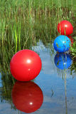 Balloons swimming on water Royalty Free Stock Photos