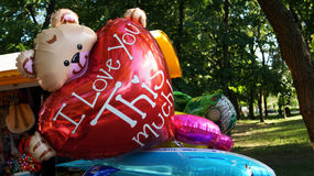 Balloons with teddy bear and a red heart Stock Image