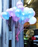 Balloons tethered in the street stock images