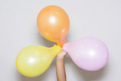 Balloons three color on white background. Stock Photo