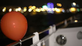 Balloons tied to the stern of a boat. The river bus. Night shot. Balloons tied to the stern of a boat, which floats on the river in St. Petersburg. The river stock video