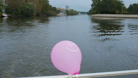 Balloons tied to the stern of a boat. The river bus. stock footage
