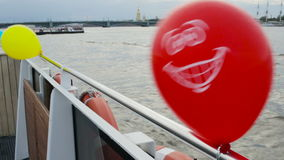 Balloons tied to the stern of a boat. The river bus. stock video