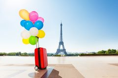Balloons tied to suitcase left on Paris streets Royalty Free Stock Photography