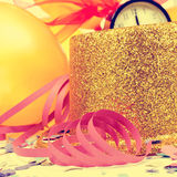Balloons, top hat, streamers and confetti for the new years part. Golden balloons, golden top hat, streamers and confetti for the new years party, with a retro Royalty Free Stock Images