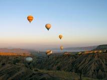 balloons in turkey, rising sun, cappadocia