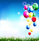 Balloons under blue sky and beauty grass. Illustration of balloons under blue sky and beauty grass Stock Photo