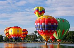 Balloons on the water. Hot air balloons touching water in lake Stock Photography