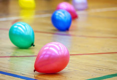 Balloons on wooden floor of sports hall Stock Image