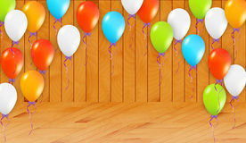 Balloons in wooden room Royalty Free Stock Photography