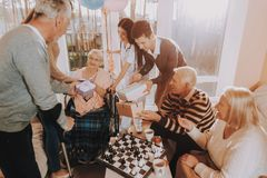 Balloons. Young and Old People. Nursing Home. Balloons Young and Old People. Nursing Home Birthday Party. Elderly Woman. Guests. Celebration. Give Gifts Very royalty free stock photo