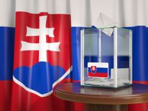 Ballot box with flag of Slovakia and voting papers.  Royalty Free Stock Images