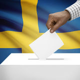 Ballot box with national flag on background series - Kingdom of Sweden. Ballot box with flag on background - Kingdom of Sweden stock photo