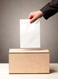 Ballot box with person casting vote Royalty Free Stock Image