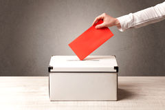 Ballot box with person casting vote Stock Photography