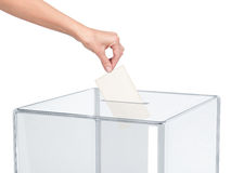 Ballot box with person casting vote on blank voting slip. Isolated on the background Stock Photo
