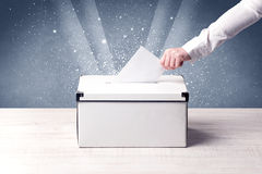 Ballot box with person casting vote Royalty Free Stock Photography