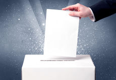 Ballot box with person casting vote Royalty Free Stock Photos