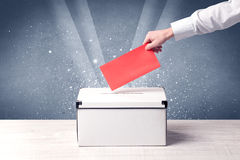 Ballot box with person casting vote Royalty Free Stock Images