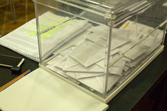 Ballot box with votes. Made of plexiglass over the election table Stock Photos