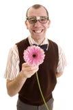 Ballot de sourire offrant une fleur. Photo libre de droits