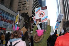 Ballots Not Bullets, NRA, March for Our Lives, NYC, NY, USA. Women participating in the March for Our Lives in New York City wear pink pussyhats, popular symbol Royalty Free Stock Image