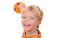 Ballplaying boy Stock Images