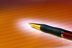 Ballpoint Ink Pen on Blank Sheet of Paper stock image