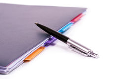 Ballpoint neatly organized notebook. Stock Photos