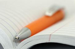 Ballpoint Pen. In a Notebook royalty free stock photography
