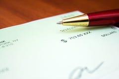Ballpoint pen. On a check Stock Photography