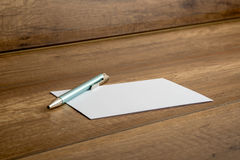 Ballpoint pen and blank card on a table Stock Images