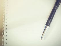Ballpoint pen on blank sheet notebook (Vintage tone) Stock Images