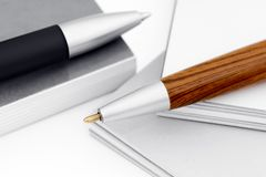 Ballpoint pen on the book and catalog. Stock Photos