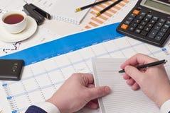 Ballpoint pen, calculator, hand Stock Images