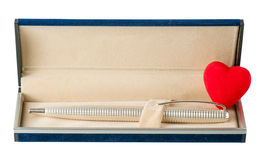 Ballpoint pen in the case with an open heart Royalty Free Stock Photos