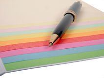 Ballpoint pen and color papers Royalty Free Stock Photos
