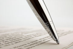 Ballpoint pen on contract Stock Photography