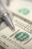 Ballpoint pen and dollars Stock Image