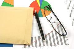 Ballpoint pen, envelopes and glasses stock photo