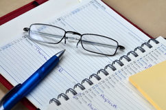 Ballpoint pen and glasses Stock Photography