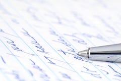 Ballpoint pen and handwritten sheet. Stock Images