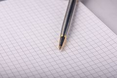 Pen on a notebook close-up stock image