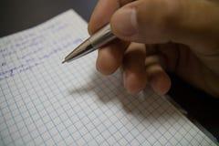 Ballpoint Pen. Macro. Ballpoint Pen on Workbook blurred background. Macro Stock Image
