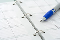 Ballpoint pen on notebook Royalty Free Stock Photos