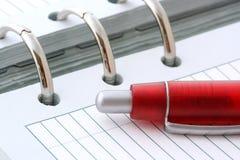 Ballpoint Pen on Notebook Stock Photography