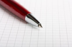 Ballpoint pen on notebook. Ballpoint pen on a sheet of notebook closeup Royalty Free Stock Photo