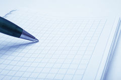 Ballpoint pen and notebook Stock Photography
